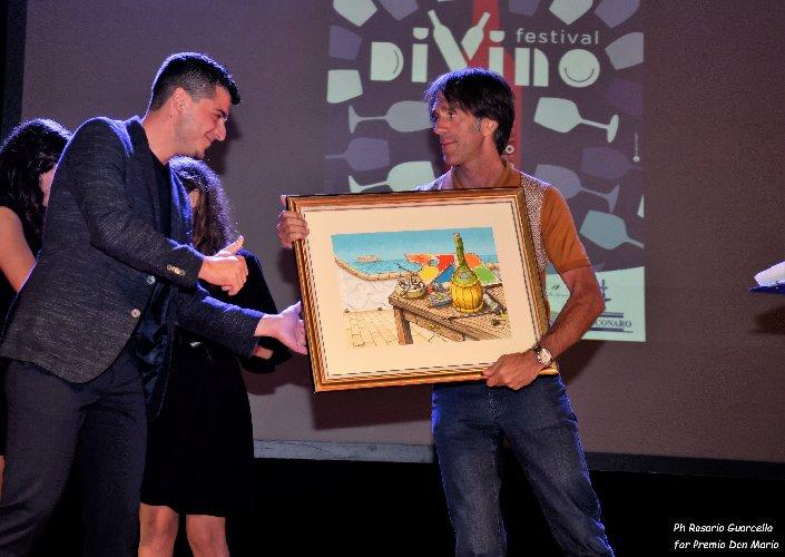 https://www.ragusanews.com//immagini_articoli/05-08-2018/1533467537-davide-oldani-carlo-petrini-premiati-divino-festival-1-500.jpg