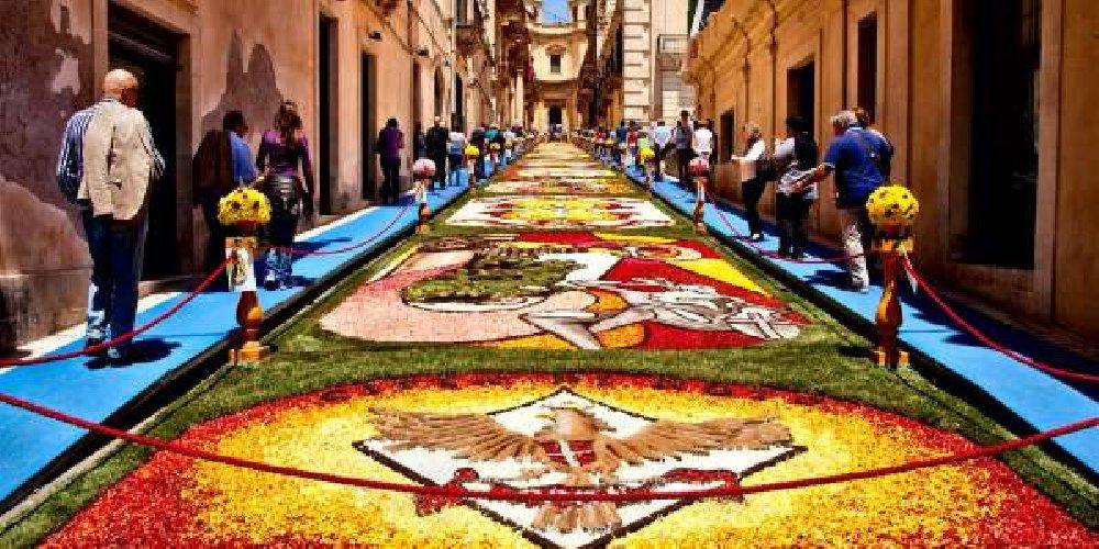 https://www.ragusanews.com//immagini_articoli/11-05-2019/linfiorata-di-noto-abbraccia-i-siciliani-che-vivono-in-america-500.jpg
