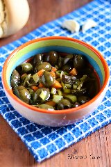 https://www.ragusanews.com//immagini_articoli/17-11-2019/olive-verdi-schiacciate-ricetta-siciliana-240.jpg