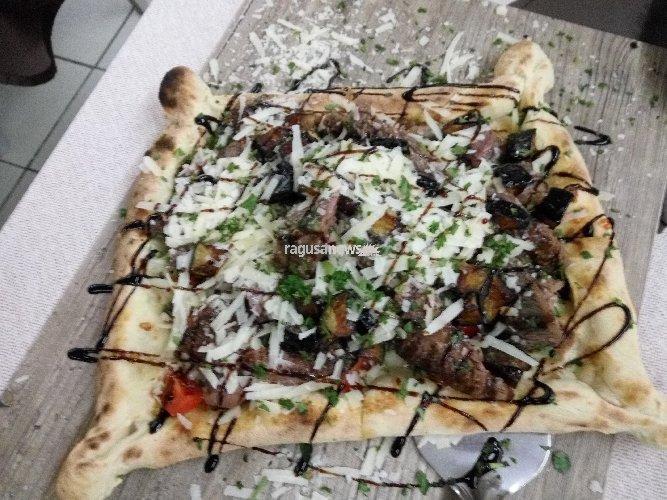 https://www.ragusanews.com//immagini_articoli/29-01-2018/pizza-fellini-ribera-dovrebbe-essere-patrimonio-dellumanita-500.jpg